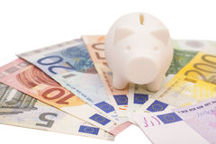 Piggy bank surrounded by Euro notes Stock Image