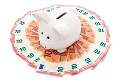 Piggy bank surrounded by ten Euros notes Royalty Free Stock Photography