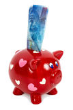 Piggy bank and 100 swiss franc banknote Stock Photo