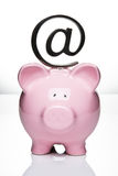 Piggy bank with at symbol Royalty Free Stock Image