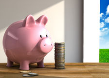 Piggy bank on table Stock Photography