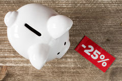 Piggy-bank with tag of discount or sale Stock Photo