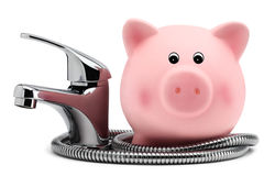 Piggy bank with tap water saving concept Royalty Free Stock Image