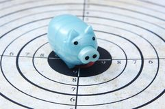 Piggy bank on target concept Stock Photos