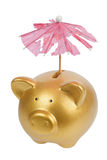 Piggy bank with tattered umbrella Royalty Free Stock Image