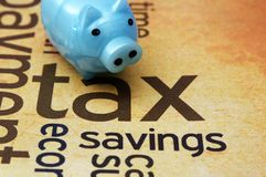 Piggy bank and tax concept Royalty Free Stock Photos
