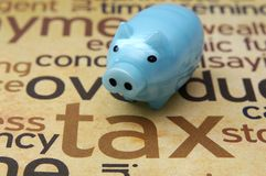 Piggy bank and tax concept Royalty Free Stock Images