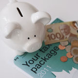 Piggy Bank With Tax Forms Royalty Free Stock Photo