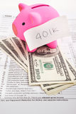 Piggy bank and tax forms Royalty Free Stock Photo