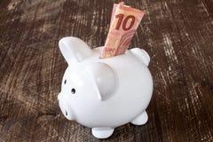 Piggy bank and ten euro banknote. Stock Photo