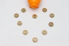 Piggy bank and ten rupee coin of India. Royalty Free Stock Photos
