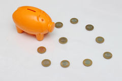 Piggy bank and ten rupee coin of India. Royalty Free Stock Photography