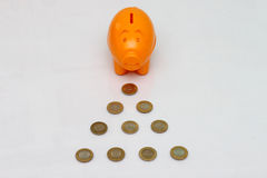 Piggy bank and ten rupee coin of India. Stock Photography