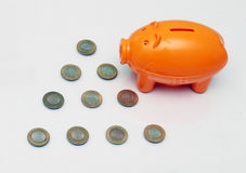 Piggy bank and ten rupee coin of India. Royalty Free Stock Images