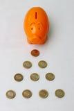 Piggy bank and ten rupee coin of India. Stock Photos