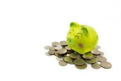 Piggy bank on Thai coins. Royalty Free Stock Photo
