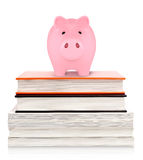 Piggy bank on top of books Stock Photography