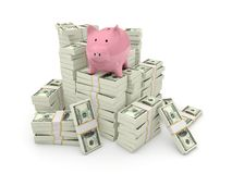 Piggy bank on top of pile of dollars Royalty Free Stock Images
