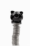 Piggy bank on top of pile of euro coins black and white. Isolated on white background Royalty Free Stock Images