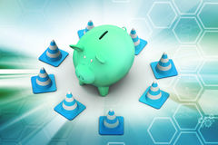 Piggy bank with traffic cone Stock Image