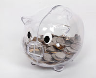 Piggy Bank. Transparent Piggy Bank wit coins Royalty Free Stock Photography