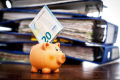 Piggy bank and twenty euro note Stock Photos