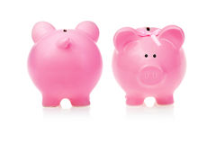 Piggy Bank: Two Points of View. At the White Background Royalty Free Stock Photos