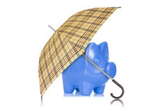 Piggy bank with umbrella on white background Royalty Free Stock Image