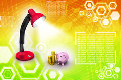 Piggy bank under the  table lamp Royalty Free Stock Image