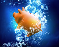 Piggy bank under water Stock Images
