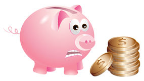 Piggy bank is unhappy with the bronze coins Royalty Free Stock Photography
