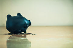 Piggy Bank Upside Down And Coins Debts And Financial Problems Concept. Stock Photography