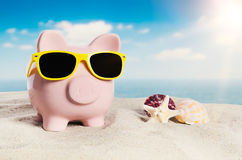 Piggy bank on vacation. Concept of holidays economy Stock Photo