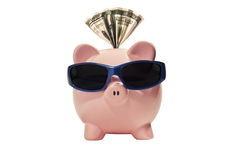 Piggy bank with sunglasses Stock Photo