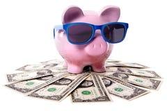 Piggy Bank vacation travel money savings, dollar bills Stock Photography