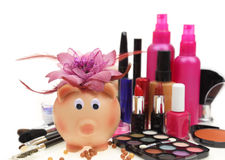 Piggy bank with various cosmetics Royalty Free Stock Images