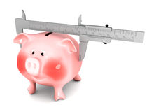 Piggy bank and vernier calliper royalty free stock images