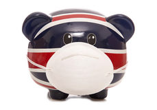 Piggy bank wearing anti pollution mask Stock Photos