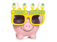 Piggy bank wearing birthday glasses Royalty Free Stock Photos
