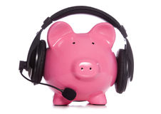 Piggy bank wearing bluetooth headset. Studio cutout Stock Images