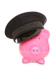 Piggy bank wearing chauffeur hat Royalty Free Stock Photos