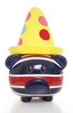 Piggy bank wearing clown hat Stock Photo