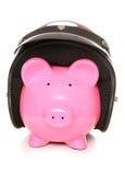 Piggy bank wearing a crash helmet Royalty Free Stock Photos