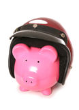 Piggy bank wearing a crash helmet Royalty Free Stock Image