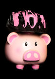 Piggy bank wearing a cycling helmet Royalty Free Stock Images