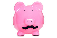 Piggy bank wearing a fake moustache Royalty Free Stock Photos