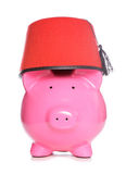 Piggy bank wearing a fez hat Stock Image