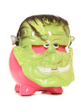 Piggy bank wearing a frankenstien halloween mask Stock Image