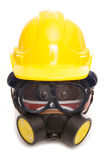 Piggy bank wearing gas mask and builders hard hat Stock Photography