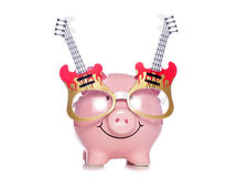 Piggy bank wearing guitar glasses. Studio cutout Stock Photography